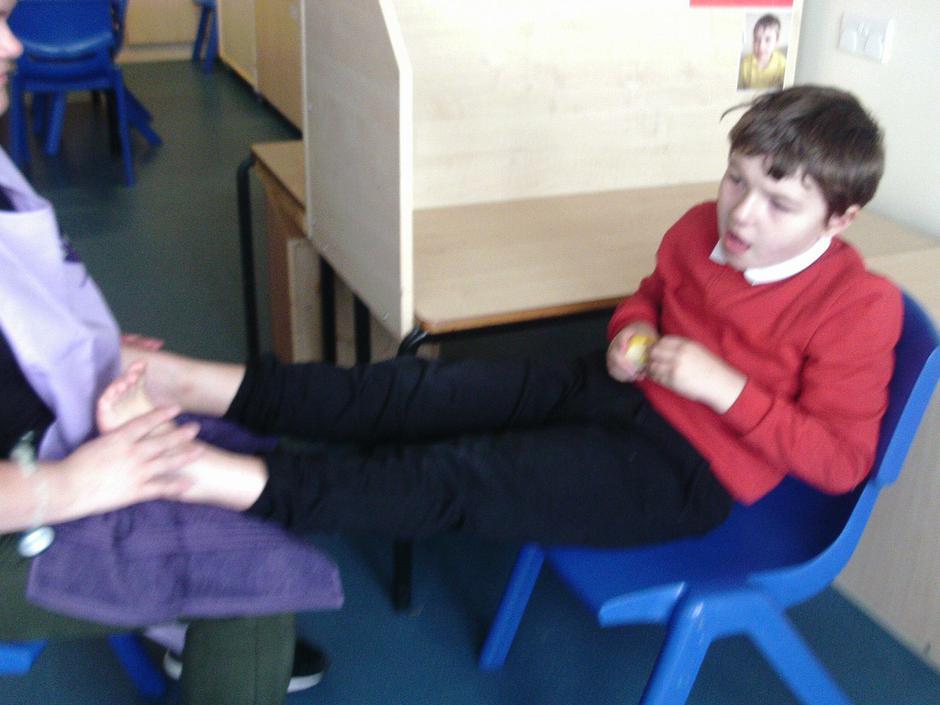Jack having a foot massage in Reflexology