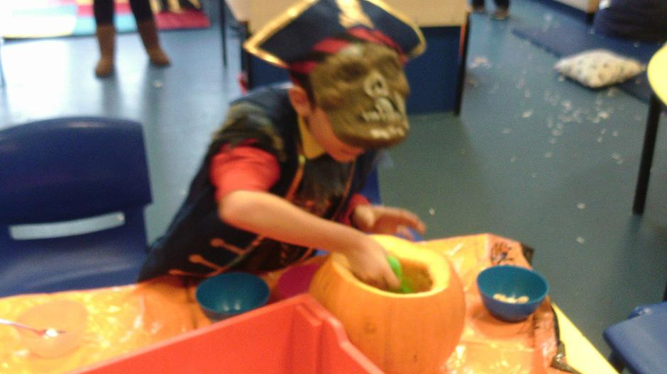 James scooping and carving our class pumpkin