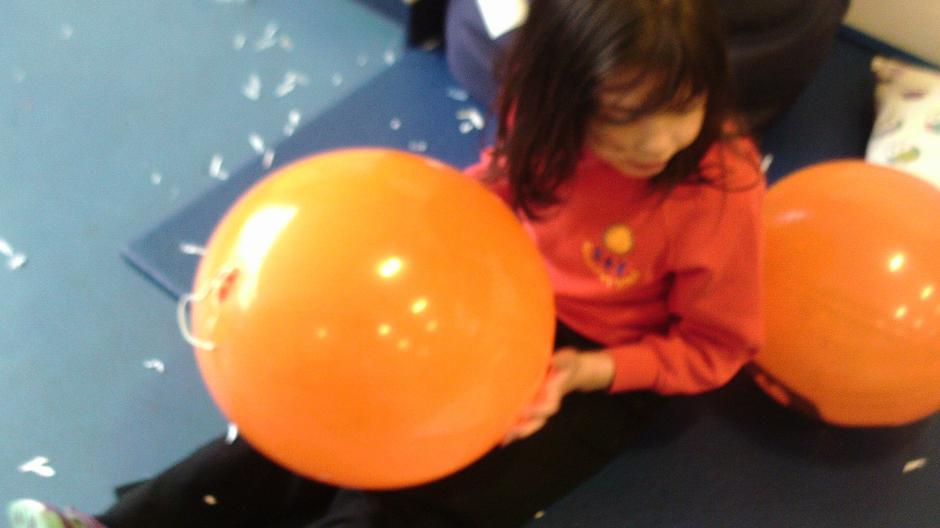 Maya exploring the sensory balloons