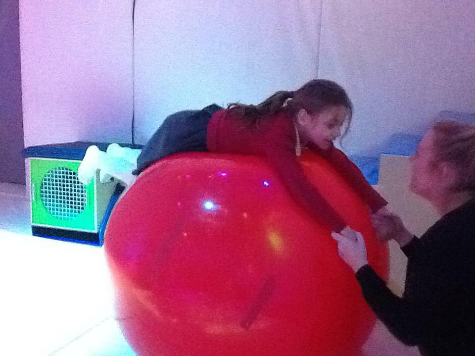 Evie playing on the big ball