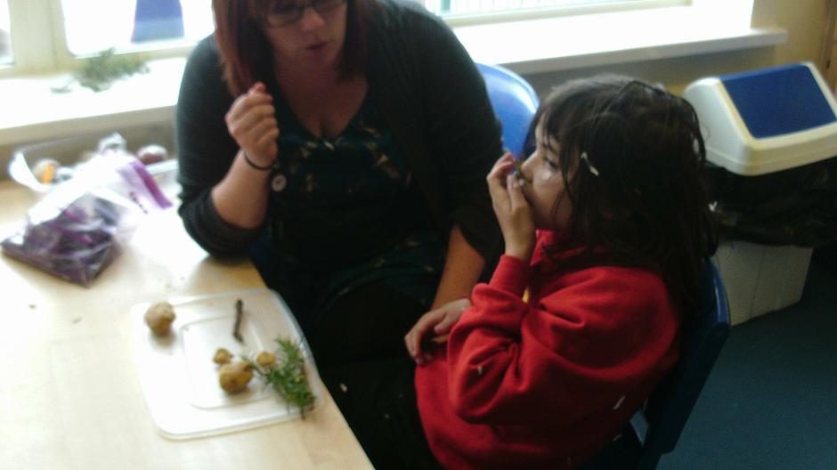 Maya exploring sensory play doh with herbs & spice