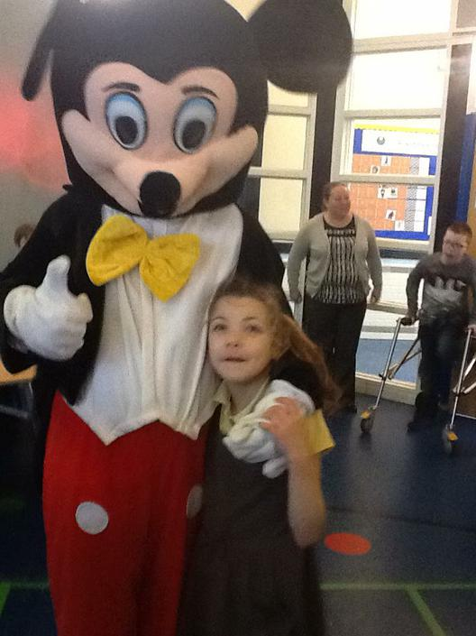 Evie met Mickey Mouse at the disco