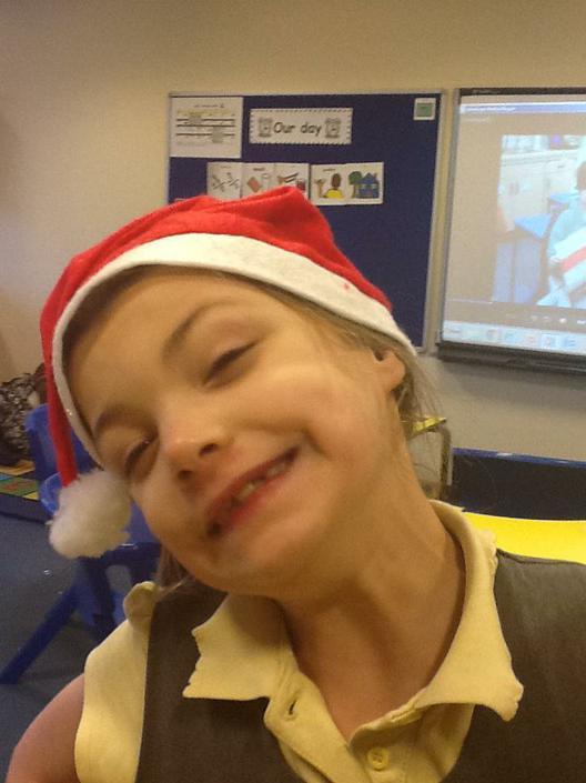 Evie dressed as Santa