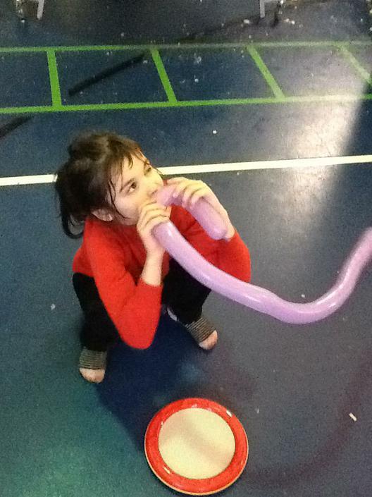Maya enjoying playing with balloons