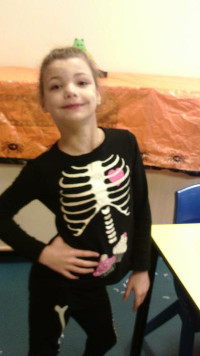 Evie dressed as a skeleton