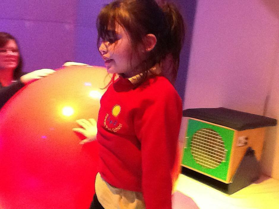 Maya playing with the big ball