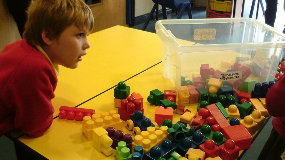 Ben exploring the blocks in construction