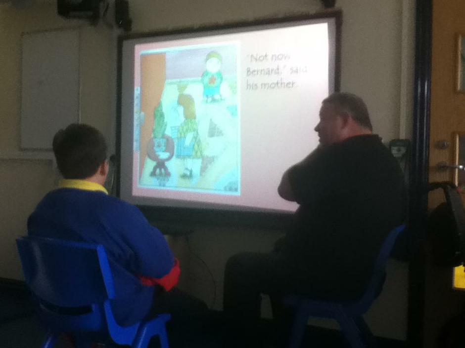 Literacy with Alexander reading aloud.