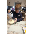Alfie completing Mrs Anderson's baking challenge