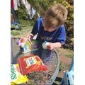 Freddie making a birdhouse. Wonderful idea!.JPG