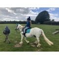 Grace has been riding lots!