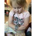 Taking care of Tinkerbell the Hamster.JPG