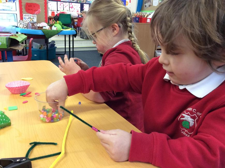 Threading beads to make the stamen in our flowers
