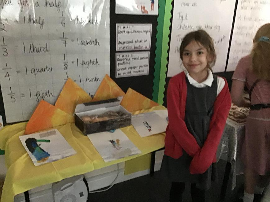 Showing off her project