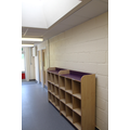 Early Years and Key Stage One children use cubby holes for their belongings.