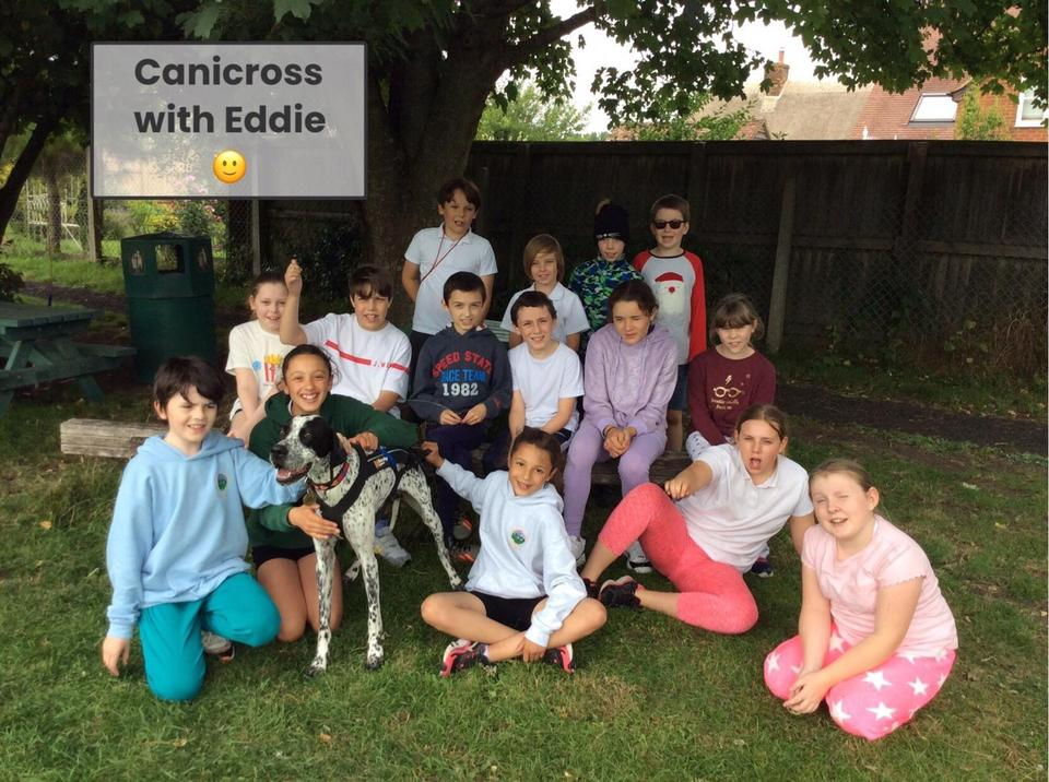 Our oldest bubble trying canicross with Eddie the school dog