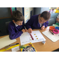 Use place value counters to show how to complete short multiplication when exchanging.