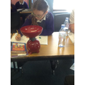 In Maths, we used scales to measure the mass of items in the classroom.