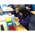 Counting out 1000 cubes to balance the 1kg weight