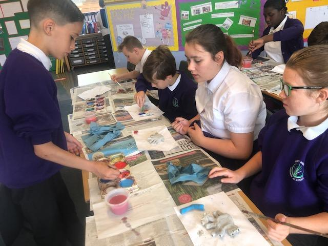 Painting our heart clay sculptures
