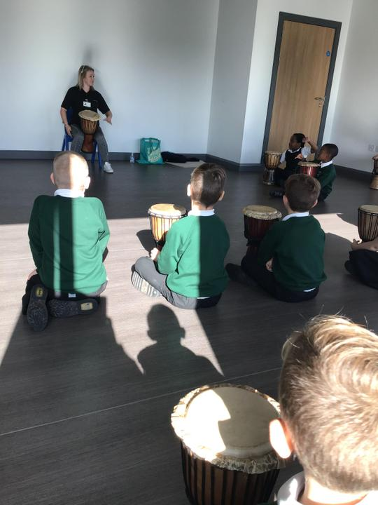 Our visit from the African drummer specialist. We looked learning some drumming skills.