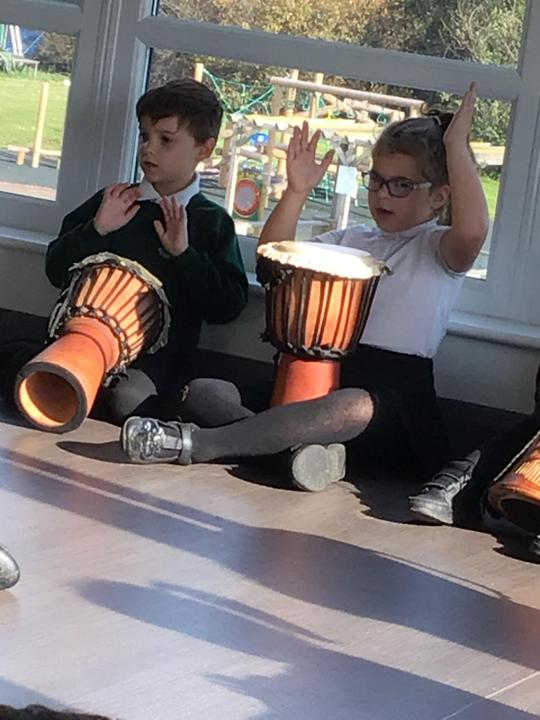 Our visit from the African drummer specialist. We loved learning some drumming skills.