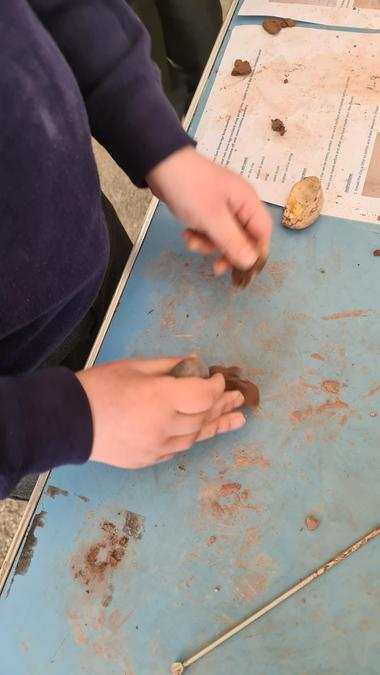 Tine to turn our animal bones into jewellery (we made clay bones)