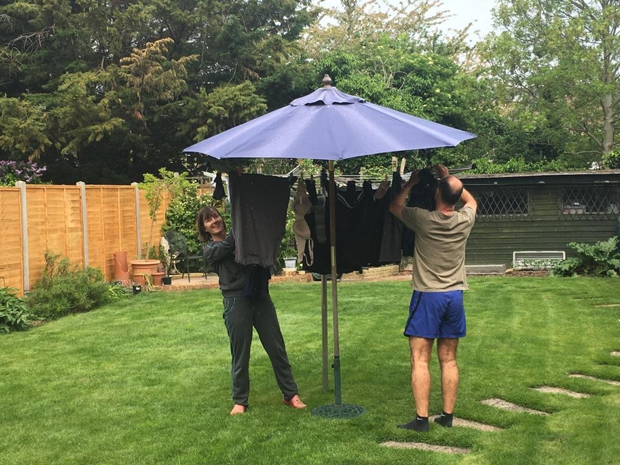 Mrs Q trying to get her laundry dry in the rain!