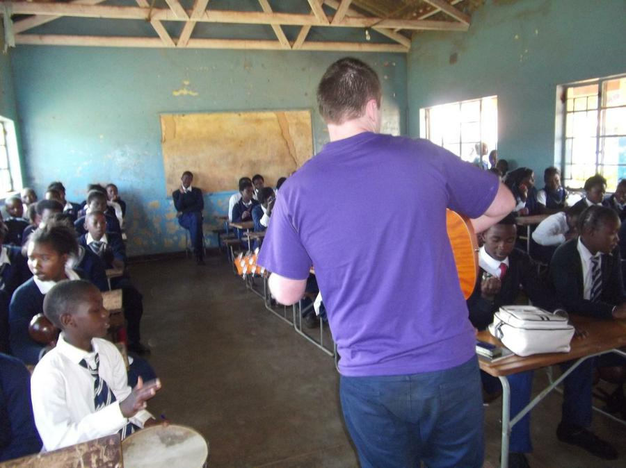 Children being entertained by UK charity worker