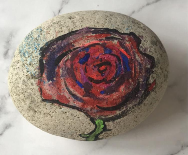 Charlie's beautiful rose painting on a stone!🌺