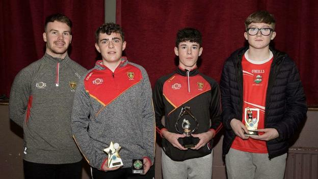 Special guest Darragh O'Hanlon with from left, Dundrum U-16 Sportsperson Joel McKibbin, Player of the Year Conor Rogan and Most Improved Tiernan Hillen