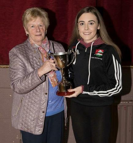 The inaugural Paddy (Butcher) Ward Memorial Cup winner Alice McAlea (right) being presented the trophy by Paddy's wife June.