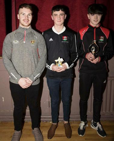 Special guest Darragh O'Hanlon with Dundrum U-14 Sportsperson winner Coran Coughlan (centre) and Player of the Year Sean Mulholland (right.) Missing from photo is Most Improved winner Eoin Flynn.