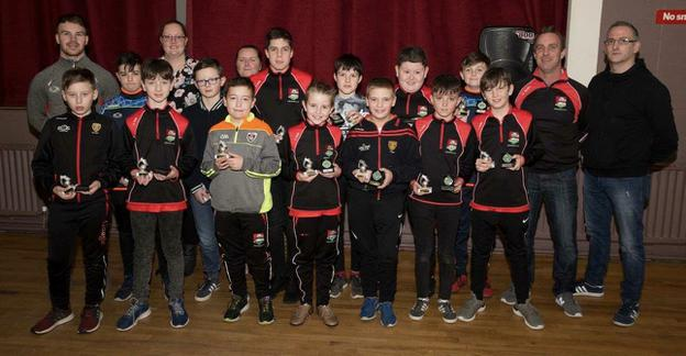 The Dundrum U-12 players with team mentors and special guest Darragh O'Hanlon. All of the panel members were awarded the Player of the Year award such was this group of players commitment to their team and club