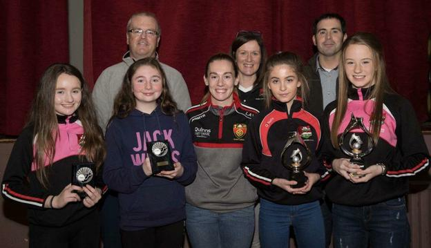 Special guest Chara Laverty (front centre) with from left Dundrum U-14 girls' Sportsperson Jodie Cunningham, Most Improved Eva Leneghan and Joint Player of the Year winners Chloe Trainor and Kirsten Cunningham. Team mentors in the back row