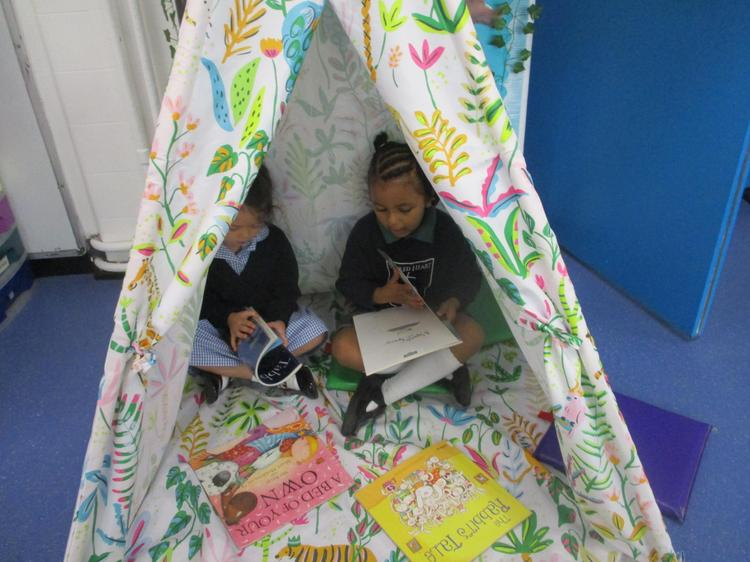Isla reads FunnyBones in our reading tent!