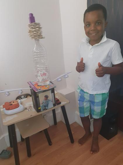 Demilade builds a tower for Mum and Dad!