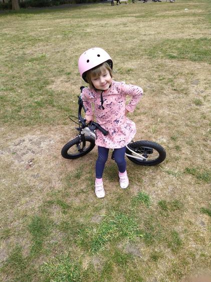 Learning how to ride her bike!