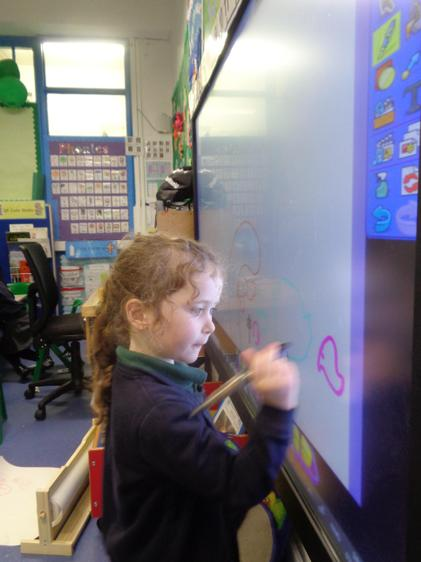 Florence draws a journey of the skeleton's journey on the interactive whiteboard!