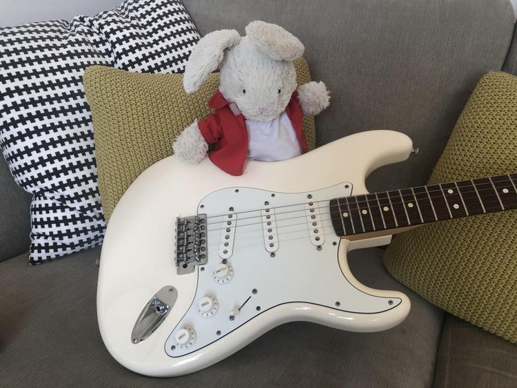 Reggie plays the guitar!