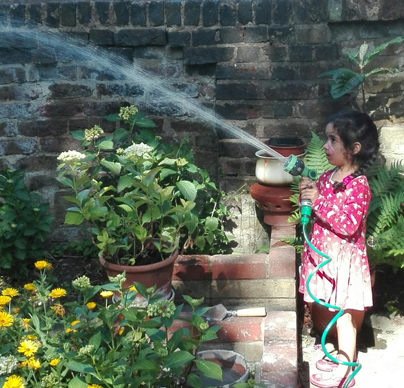How kind of you Leyla to water Grandad's flowers.
