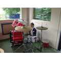 Drumming a beat.