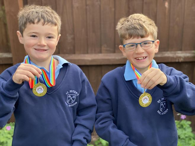 James and Jacob deserve to be very proud of their medals!