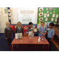The children took part in a Baptism role play. .