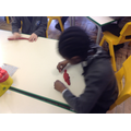 Children were using play dough to make Reptiles.