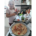 Lilah T busy making her designed pizza.