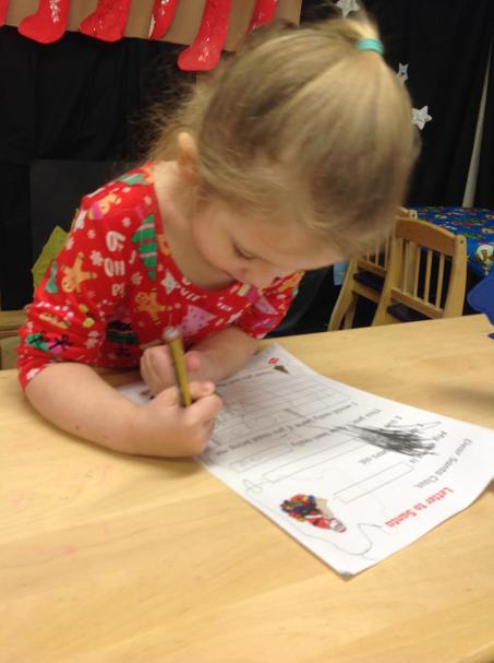 Writing a letter to Santa.