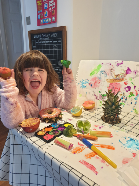 Olivia has been painting with fruit and vegetables.