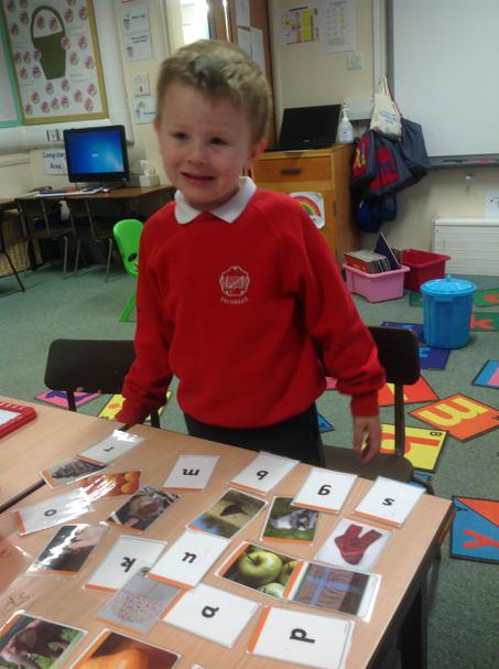 Learning to hear and recognise initial sounds.