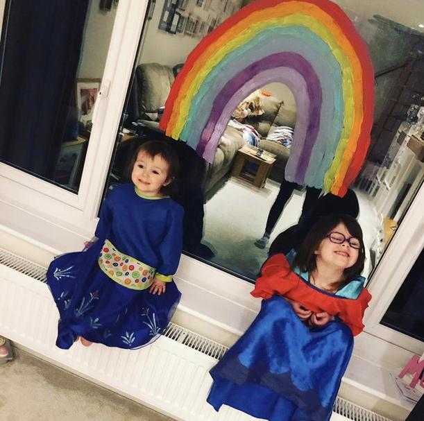 A superhero rainbow - Olivia and her big sister.